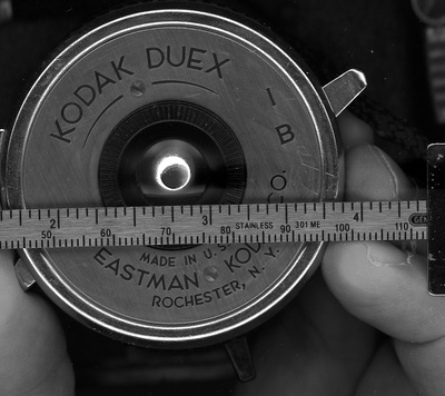 Lens of Duex with a scale in front of it