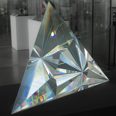 Large triangular shiny piece with smaller facets inside