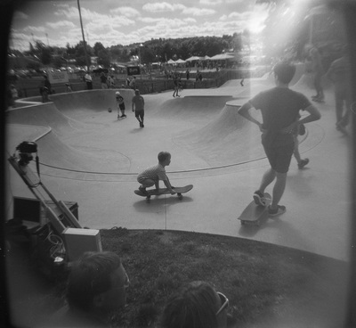 Kids on skateboards in a concrete bowl